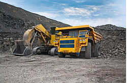 Picture of a large mining truck and an excavator