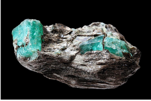 An emerald gemstone in organic condition