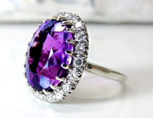 A purple gemstone on a ring