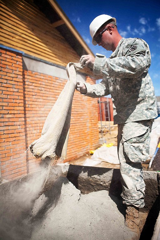 Solider pouring the fine powdery cement