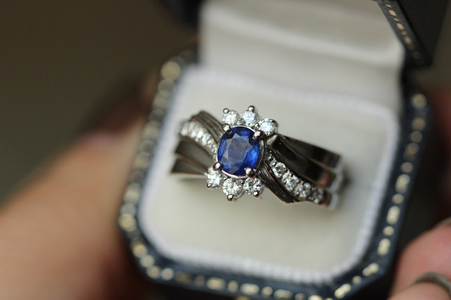 Engagement ring with blue crystal in center